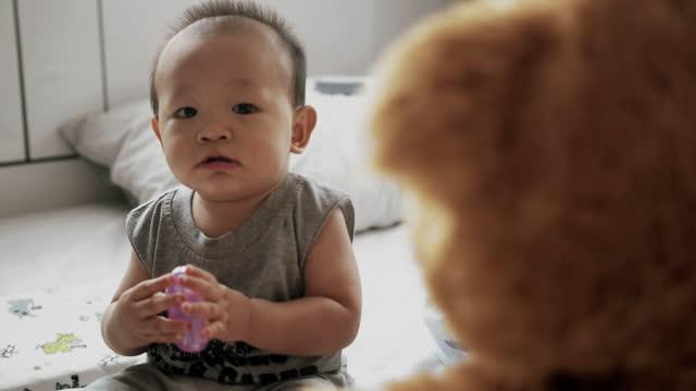 little boy with teddy bear - teddy boy stock videos & royalty-free footage