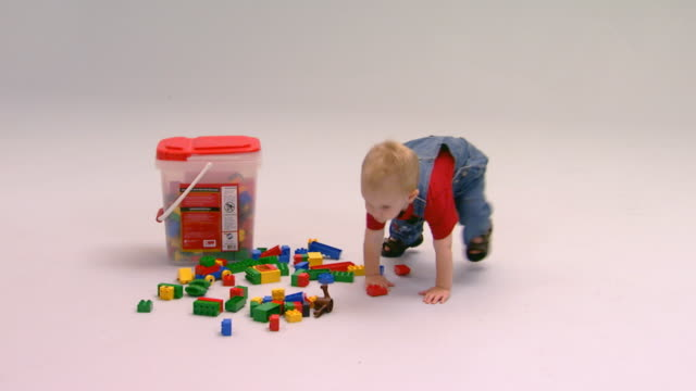 little boy with toys - bib overalls stock videos and b-roll footage