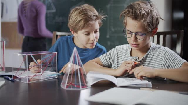 little boys attending to mathematics lesson - mathematics stock videos & royalty-free footage