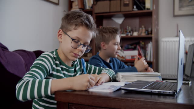 little boys attending to online school class. - person in education stock videos & royalty-free footage
