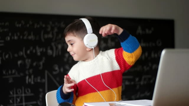little boys attending to online school class. - attending stock videos & royalty-free footage
