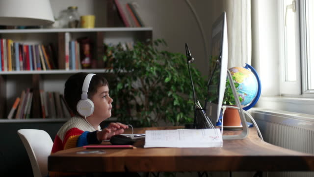little boys attending to online school class. - back to school stock videos & royalty-free footage