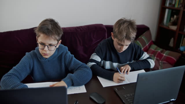 little boys during covid-19 quarantine attending to online school class. - remote location stock videos & royalty-free footage