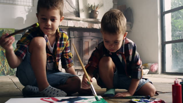 Little boys painting at the artist's studio