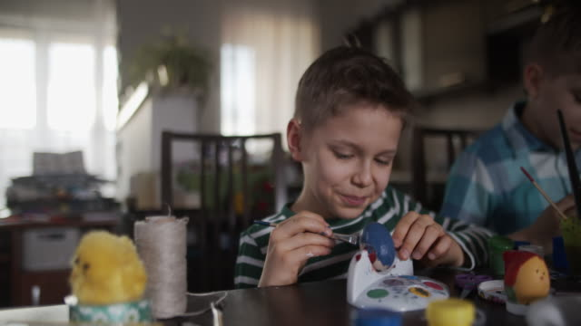 little boys painting easter eggs - craft stock videos & royalty-free footage