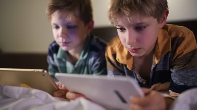 little boys playing games on digital tablets - lying on front stock videos & royalty-free footage