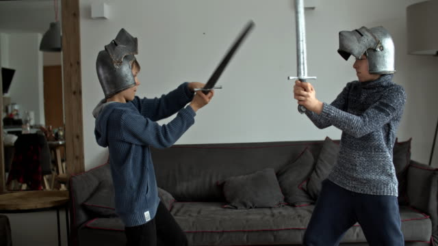 little boys playing knights at home - leisure activity stock videos & royalty-free footage