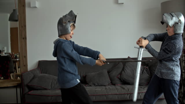 little boys playing knights at home - helmet stock videos & royalty-free footage