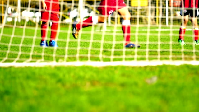 Little boys playing soccer.