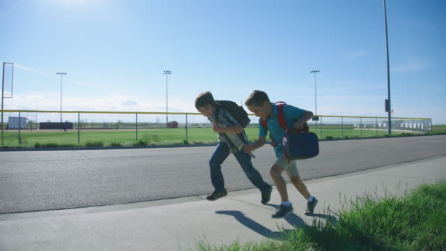little boys run to school - rucksack stock videos and b-roll footage