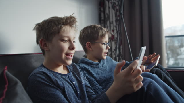 little boys using digital tablets - pre adolescent child stock videos & royalty-free footage