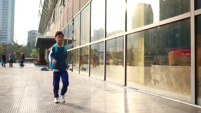 little boys walk to school - schoolboy stock videos & royalty-free footage