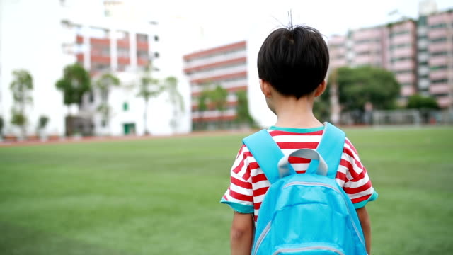 little boys walk to school - one boy only stock videos & royalty-free footage