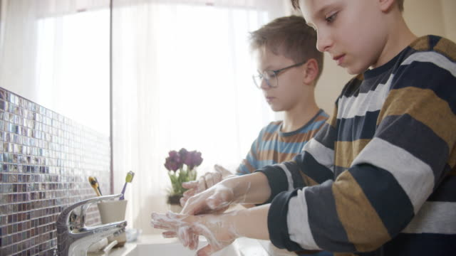 little boys washing hands thoroughly - accuracy stock videos & royalty-free footage