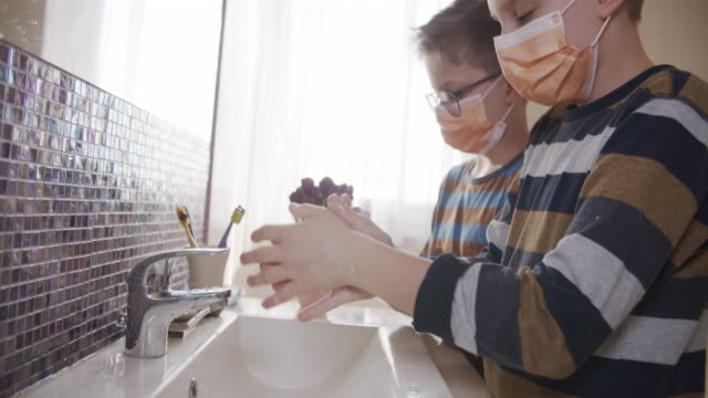 little boys washing hands thoroughly - protective workwear stock videos & royalty-free footage