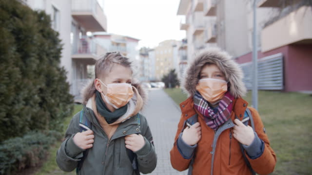 little boys wearing gas masks going to school - surgical mask stock videos & royalty-free footage