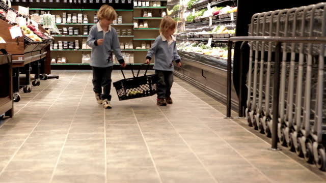 Little Boys With Shopping Basket In Store