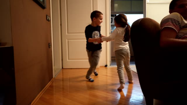 little brother and sister playing on the floor - brother stock videos & royalty-free footage