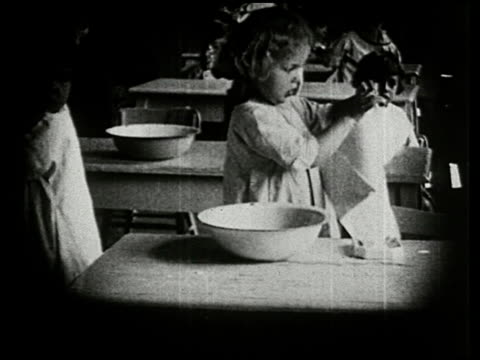 little brothers and sisters: a film lesson in health and hygiene - 15 of 15 - see other clips from this shoot 2362 stock videos & royalty-free footage