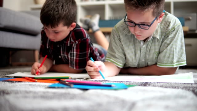 little brothers enjoying drawing on the floor - children only stock videos & royalty-free footage
