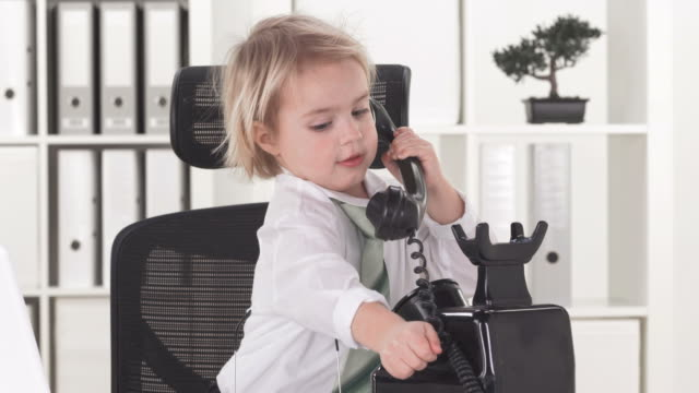 hd: little business boy calling someone - adult imitation stock videos & royalty-free footage
