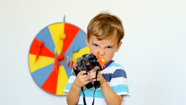 little child boy playing with a toy gun - toy gun stock videos & royalty-free footage