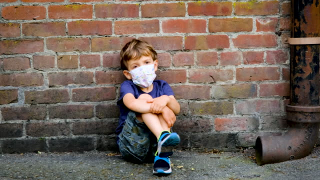little child boy sitting on the floor wearing a protective mask - child sitting cross legged stock videos & royalty-free footage