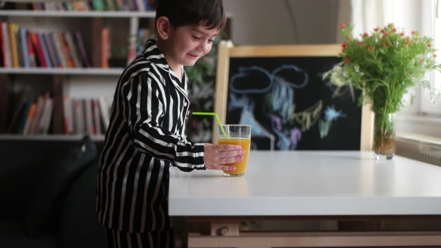 little child drinking homemade orange juice - one boy only stock videos & royalty-free footage