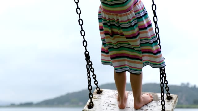 little child swinging on a wooden swing - swing play equipment stock videos & royalty-free footage