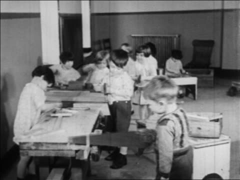 little children playing with tools in nursery school / wpa project / newsreel - wpa stock videos & royalty-free footage