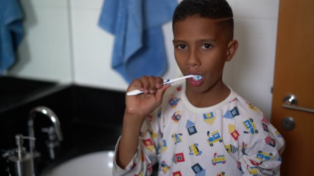 little cut kid brushing teeth - human teeth stock videos & royalty-free footage