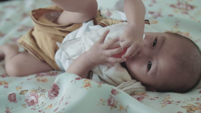 Little cute baby boy on bed