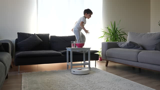 little cute boy and robot vacuum cleaner - 6 7 years stock videos & royalty-free footage