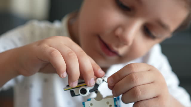 little cute boy builds solar powered robot - 6 7 years stock videos & royalty-free footage