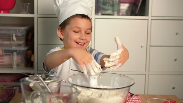 little cute boy chef is making bread with his mother - 4 5 years stock videos & royalty-free footage