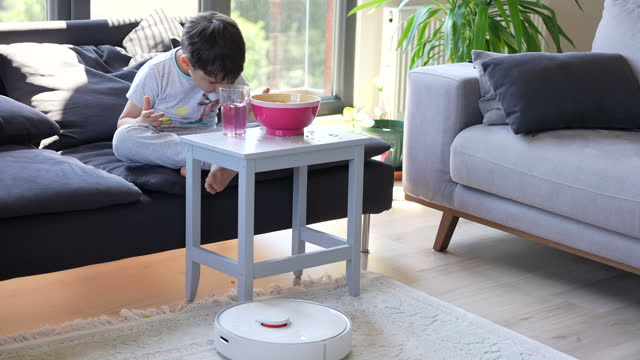 little cute boy eating chips and robot vacuum cleaner - 6 7 years stock videos & royalty-free footage