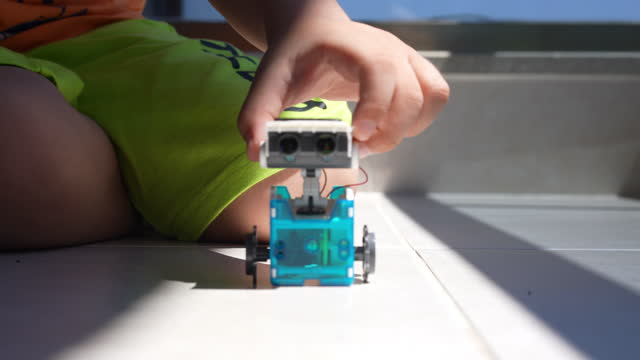 little cute boy playing solar powered robot - 6 7 years stock videos & royalty-free footage
