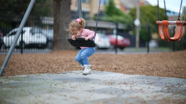 little cute child playing on playground - courtyard stock videos & royalty-free footage