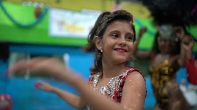 little cute girl celebrating and dancing brazilian carnival at school carnival - latin american and hispanic ethnicity stock videos & royalty-free footage