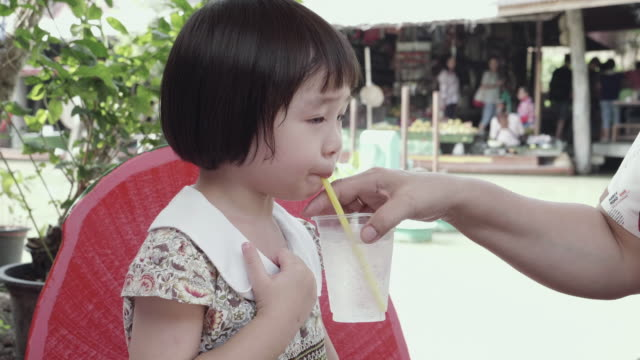cu : little cute girl drinking pure water from a glass - lap body area stock videos & royalty-free footage