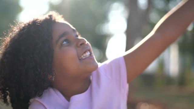 little cute girl imagination / dreaming - pardo brazilian stock videos & royalty-free footage