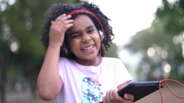 little cute girl listening music and having fun - pardo brazilian stock videos & royalty-free footage