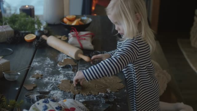 little cute girl making gingerbread cookies for christmas  (slow motion) - pastry dough stock videos & royalty-free footage