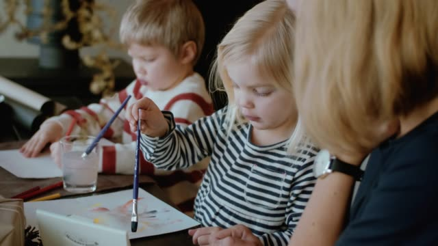 little cute girl painting picture for santa calus (slow motion) - scandinavian culture stock videos and b-roll footage