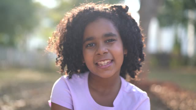 little cute girl portrait - looking at camera stock videos & royalty-free footage