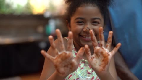 little cute girl showing her chocolate hands - messy stock videos & royalty-free footage