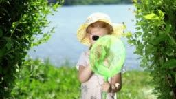 A little cute little girl is catching an insect net.