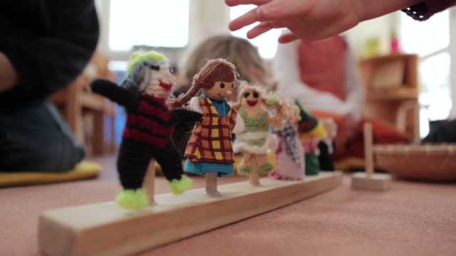 ms little dolls stand on a fixture in middle / potsdam, brandenburg, germany - preschool stock videos and b-roll footage