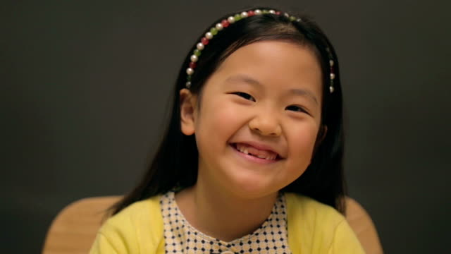 little east asian girl wearing hairband laughing - east asian ethnicity video stock e b–roll