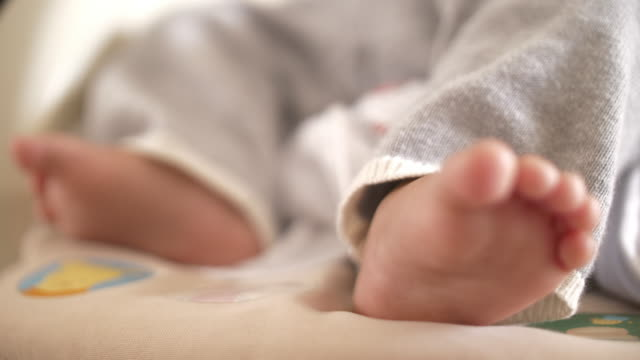 slo mo little feet baby at home - baby blanket stock videos and b-roll footage